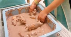 We mix corn starch and water with a little brown paint to make our mud. The plastic pigs love to roll around in the mud. We do this wit...