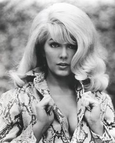 Stella Stevens - it was hard to find a decent picture of her.  She played in the Nutty Professor, Poseidon Adventure, The Courtship of Eddie's Father, Dukes of Hazzard, Reunion.