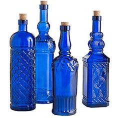 Assorted cobalt glass bottles pier 1