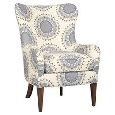 "Wingback arm chair with medallion-print upholstery and espresso-finished legs. Made in the USA. Product: ChairConstruction Material: Wood and fabricColor: Gray and whiteFeatures: Made in the USADimensions: 41"" H x 30"" W x 35"" D"
