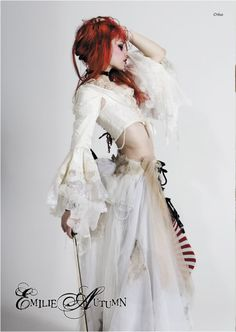 """Emilie Autumn Liddell (born 22 September 1979), better known by her stage name Emilie Autumn, is an American singer-songwriter, poet, and violinist. Autumn draws influence for her music—the style of which she has alternatively labeled as """"Victoriandustrial"""" and glam rock—from plays, novels, and history, particularly the Victorian era. Photographer unknown."""