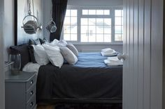Grey toned bedroom with unusual lights. Angmering-on-Sea, West Sussex UK