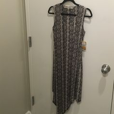 Rachel Roy asymmetric wrap dress Snakeskin print dress that has a wrap part which drapes to a point in the front. Really silly material, brand new with tags. Cheaper on Merc. Ari. Rachel Roy Dresses Asymmetrical