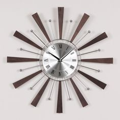 """Found it at Wayfair - 19.25"""" Spindle Wall Clock"""
