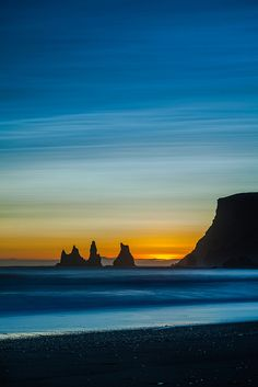 Reynisdrangar at sunset (by Jokull) Reynisdrangar are 66 mtr's high sea stacks near Vik in Iceland. Beautiful Sunset, Beautiful Places, Beautiful Scenery, Landscape Photography, Nature Photography, Photography Tips, Travel Photography, Wedding Photography, Cool Pictures