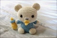 Free Pooh Bear crochet pattern | Free Amigurumi Patterns | Bloglovin' ----------------This one shown looks nothing like Pooh-bear, but it's still adorable. <3 the pacifier and bottle!