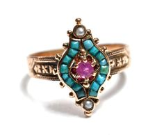 Victorian Persian Turquoise & Ruby 14K Rose Gold Ring circa 1890. Turquoise in gold has been very popular throughout Europe for well over 500 years.
