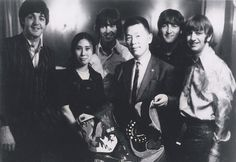 Interpreter Kimi Aida (center left) and Tetsusaburo Shimoyama, manager of the Shochiku Central movie theater and head of the Beatles Fan Club of Japan, pose for a photo with Paul McCartney, George Harrison, John Lennon and Ringo Starr during their visit to Tokyo in 1966