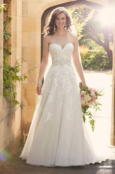 This classically elegant lace and tulle A-line wedding dress from Essense of Australia features gorgeous beaded lace throughout its fitted bodice and voluminous tulle skirt.