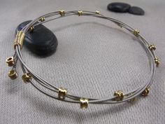 guitar string bracelet, I've been wanting to make some....can't find the right DIY