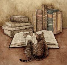 Des chats et des livres, tout ce qu'aime. Le vrai bonheur...