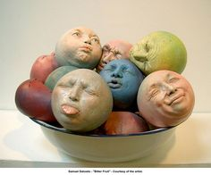 "kind of reminds me of ""man in the moon"" faces. - these might be pretty funny in a garden or lined up on a shelf"