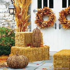 inviting, organic accessories for your fall decor: corn stalks, grape vines, wheat bundles, and changing leaves