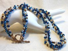 Sparkly blue and gold crystal necklace, twisted three strand necklace, holiday necklace, bronze toggle closure, opalite crystals by #EyeCandybyCathy on Etsy