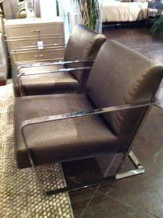 Bohemian club chair by Ralph Lauren at High Point market. Sleek, comfortable, precise...  #hpmkt #stylespotters