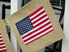 Create a festive holiday banner using burlap, jute twine, and flags!