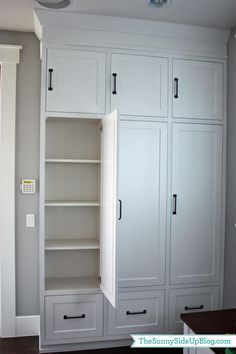 Love these locker units with adjustable shelves, small cabinets above them, and drawers below.