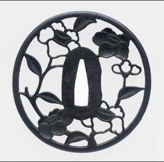 Tsuba (sword guard) with design of camellias, Japanese, Edo period, early to mid-18th century