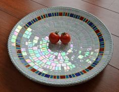 Inez White glass mosaic dish, The white glass has a pearly sheen. Cut glass on a bamboo dish with white and ochre grout.