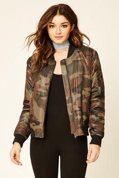 A woven bomber jacket featuring a camo print, padded shearling lining, zippered front, slanted front pockets, and ribbed collar and trim.