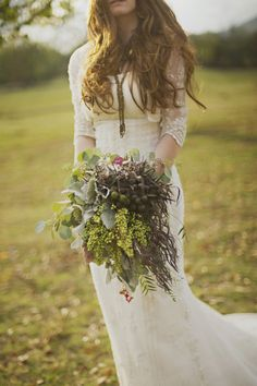 Bohemian style #wedding #bouquet made with a mix of berries and textured foliage. Get inspired at diyweddingsmag.com