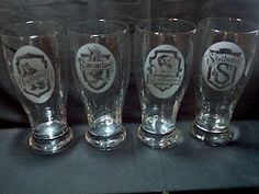 Set of Harry Potter beer glasses.  The Houses of Hogwarts crests on pilsner glasses.  These were SO much fun to make, lots of small detail that I did not even know if I could actually do.