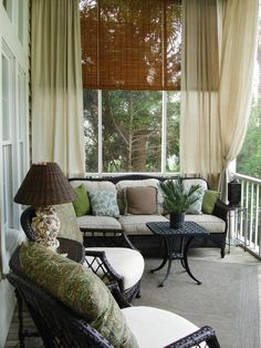 Cozy porch...love the curtains