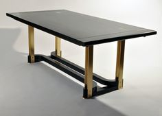 dining table by Matthew Fairbank Design - brass and hardwood.