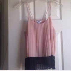 bar III sleeveless pleated camisole All over pleating, lined, hits at hip. Beautiful mauve/pale pink color with black trim. Poly. Perfect for under a blazer. Bar III Tops Camisoles