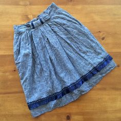 Anthropologie Ric Rac Linen Skirt Linen and cotton, denim looking with royal blue ribbon decorations on base hem line and waist bow, pockets in front, half zip and button on back, 26 inch waist, 21 inch skirt, excellent condition Anthropologie Skirts A-Line or Full