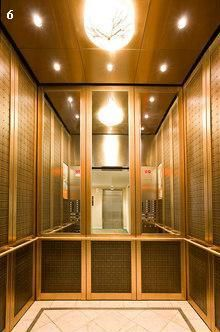 Elevator cab pulp studio glass panels with bronze woven for Luxury home elevators