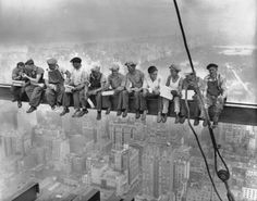 Eleven men eating lunch, seated on a girder with their feet dangling hundreds of feet above the New York City streets. Charles C. Ebbets took the photo on September 29, 1932 on the 69th floor of the RCA Building during the last months of construction.