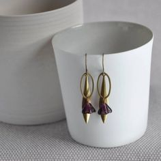 Purple Longleaf Bell Flower Earrings from ArtySmartyShop.com   Gorgeous antiqued brass and Czech glass dangly bell flower bead earrings on an elegant hook.These dainty hanging leaf earrings made from antiqued brass and a pretty purple bell flower Czech glass bead, are inspired by the Irish countryside and turned into a contemporary piece to wear into our Dublin studio where we handcraft each of our beautiful pieces.  #artysmartyshop #fashion #handmadejewelry #earrings #jewelry Leaf Earrings, Flower Earrings, Earrings Handmade, Handmade Jewelry, Bold Fashion, Czech Glass Beads, Beaded Flowers, Antique Brass, Fashion Accessories