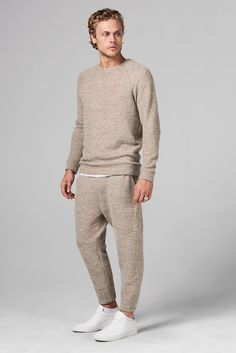 The Melange Knit Jogger Sweatpant is a sophisticated take on a classically sporty style. They taper from the knee to the cuff to create a slim, tailored shape, with trim detailing in the front for added refinement. Features a soft, lush mlange knit and a pull-on elastic waistband for extra comfort, and pockets for added utility. The tailored fit and premium make gives these joggers an effortlessly stylish look that can be dressed up or down. CONTENT: 56%POLY/ 41%COTTON/ 3%SPANDEX CARE: MACHINE W Mens Joggers Sweatpants, Slim Fit Joggers, Jogger Pants, Men's Pants, Looks Style, Lounge Wear, Casual Outfits, Mens Fashion, Shorts