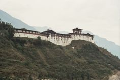 Wangdue Phodrang Dzong overlooks the convergence of the Dangchhu and Punatsangchhu. When Zhabdrung Ngawang Namgyel was in Chimi Lhakhang at Punakha, an old cripple approached him and told him that if he built a dzong in Wangdue Phodrang on a ridge that resembled a sleeping elephant, he would unite the country. Zhabdrung concluded that the old man was Yeshey Goenpo (Mahakala) and sent a noble to study the location. The noble reported that he saw four ravens circling the ridge, which flew away…