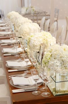 A table looks lavish when lined in white hydrangeas.