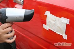 Remove a car dent with a hair dryer and compressed air