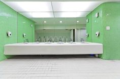 Six Undermounted Sinks Resting In A Thick White Vanity