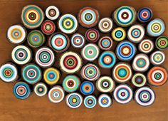 Painted tree rings on beautiful wood slices cut from fallen tree branches. An amazing array of different colors make up this bold abstract art piece. The painted tree rings can be maneuvered and arranged in different was to make a different abstract art piece each time.