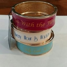"""3 bangles with fun sayings! Price is for 3 Fashion Bangle's - I bought all three new for $60 but unfortunately can't wear them for work, only one has the original tag still.   -""""go with the flow"""" -""""every hour is happy hour"""" -""""only good karma""""  Treat yourself to something fun, ships tomorrow! Please let me know if you have any questions :) can also seperate or bundle Jewelry Bracelets"""