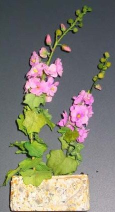 "how to: hollyhocks (to find tutorial, click on small photo of doll in blue dress on minipat home page, scroll right to ""techniques"", then ""special fleurs"". You will see a link for ""roses tremieres""...hollyhocks in French. The tutorials here are good, but the site can be a bit hard to navigate...hope the directions help!)"