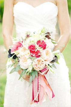 rose wedding bouquet - given drama simply yet effectively with hanging ribbon.  That's Smart... and Smashing!