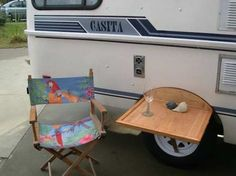 This Casita owner didn't want to drill into his fiberglass trailer, so he built a table that hooks to the tire instead.