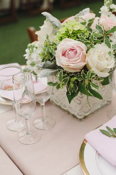 pink and white wedding centerpieces at a glamorous backyard wedding.  http://www.weddingchicks.com/2013/10/28/vintage-wedding/