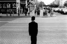 125TH STREET, HARLEM, NY. June 1994 - A churching going boy on his way to the United House of Prayer, pauses before crossing 125th street and Frederick Douglass Boulevard in the early morning late June 1994.