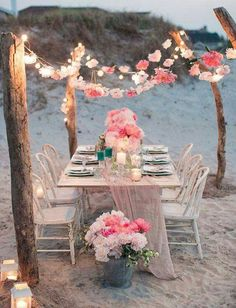 This is so pretty and perfect idea if you are having a wedding at the beach or if you live on the beach! Love the light pink flowers! So beachy and pretty in the evening for dinner!
