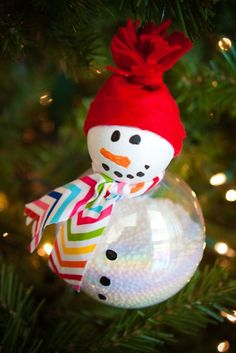 """Snowman Ornament~Christmas craft #3 @whatever: Ok...this craft is a bit more time consuming BUT all three kids said """"that is AWESOME!"""" when i showed them. You will need clear ornaments, foam balls that are smaller than the glass ornament, fake snow and scrap fabric. I found those all at hobby lobby..."""