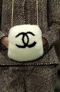 Chanel bag. Okay so I always thought these were silly, but now I just want one...