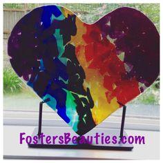 Fused glass rainbow heart sculpture.