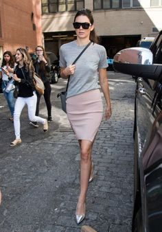 Kendall Jenner leaving the Michael Kors fashion show in New York City on Sept. 16 in a pink skirt, grey shirt and metallic pumps.